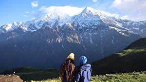 Bilder Gebirge Schnee 2 Hinten Mütze Jacke Nepal, Himalayas Natur