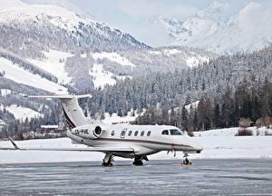 Fotos Gebirge Winter Wälder Flugzeuge Schweiz Schnee Dassault Falcon 50, St. Moritz, Airfield Luftfahrt
