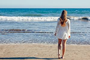 Pictures Sea Waves Beach Sand Brown haired Back view Legs young woman