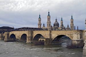 Bilder Spanien Brücke Fluss Kirchengebäude Saragossa, Puente de Piedra, Cathedral-Basilica of Our Lady of the Pillar, river Ebro, Aragon Städte