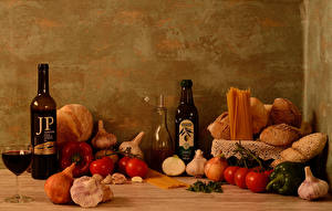Pictures Still-life Bread Wine Tomatoes Allium sativum Bell pepper Onion Bottle Stemware Pasta Food