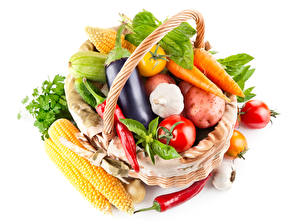Pictures Vegetables Corn Eggplant Tomatoes Carrots Garlic Chili pepper White background Wicker basket Food