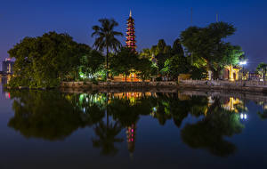 Bilder Vietnam Fluss Tempel Nacht Bäume Straßenlaterne Hanoi Tran Quoc Pagoda Natur