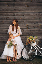 Image Bouquet Wall Wood planks Two Brown haired Little girls Brides Gown female Children