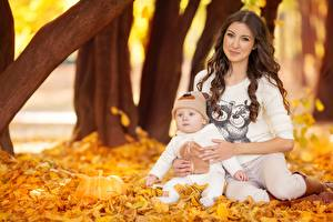 Pictures Mother Autumn Foliage Baby Brown haired Sitting Girls