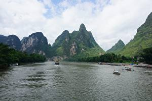 Hintergrundbilder Flusse Berg Binnenschiff China Guilin and Lijiang River national park Natur