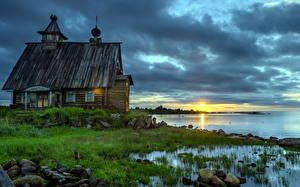 Pictures Russia Sunrises and sunsets Church Coast Old Grass Wooden Rabocheostrovsk, Karelia, Kemsky district Nature