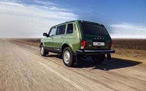 Images Russian cars Back view Driving Green Lada 4x4 Urban Niva automobile