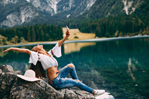 Wallpapers Selfie Brown haired Sit Hands Jeans Girls
