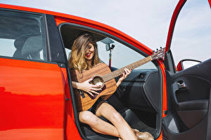 Photo Smile Guitar Sit Hands young woman