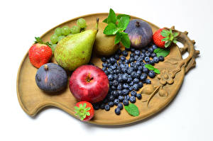 Pictures Apples Pears Strawberry Figs Grapes Blueberries Fruit White background Cutting board Food