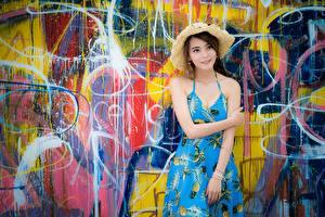 Image Asian Graffiti Walls Frock Hands Hat young woman