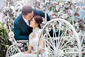 Photo Asian Man Couples in love Wedding Two Sit Groom Bride Kisses Girls