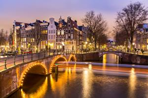 Photo Bridges Evening Building Amsterdam Netherlands Canal Cities