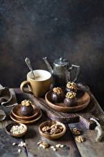 Image Coffee Nuts Chocolate Candy Walnut Wood planks Cutting board Cup Food