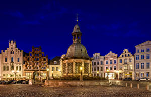 Photo Germany Houses Town square Night time Water well Street lights Wismar Wasserkunst Cities