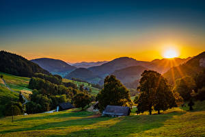 Pictures Germany Mountain Sunrises and sunsets Building Sun Trees Landscape Belchen Nature