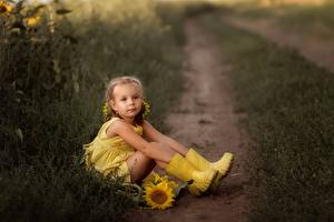 Desktop wallpapers Little girls Sitting Wearing boots Legs Path Yellow Irina Zaburaeva Children