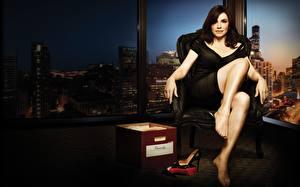 Desktop wallpapers Julianna Margulies The Good Wife (TV series) Legs Wing chair Sitting Brunette girl Movies Girls Celebrities