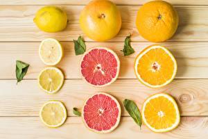Pictures Lemons Orange fruit Grapefruit Wood planks Sliced food