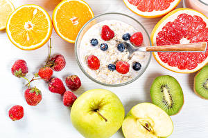 Wallpaper Muesli Fruit Orange fruit Strawberry Apples Kiwi Grapefruit Oatmeal Breakfast Food