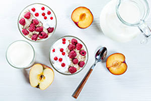 Pictures Muesli Raspberry Apples Plums Currant Milk White background Breakfast Spoon Food
