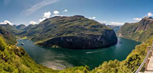 Desktop hintergrundbilder Norwegen Gebirge Landschaftsfotografie Bucht Geirangerfjord Natur