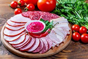 Image Sausage Ham Tomatoes Chili pepper Cutting board Sliced food Food