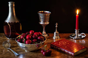 Fotos Stillleben Kirsche Kerzen Weinglas Flasche Löffel Buch Schüssel Lebensmittel