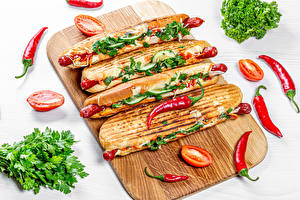 Pictures Fast food Hot dog Vegetables Tomatoes Chili pepper Cutting board Food