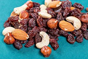 Bilder Nussfrüchte Rosinen Haselnuss Mandeln Lebensmittel