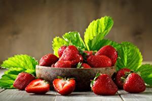 Fotos Erdbeeren Schüssel Blattwerk das Essen