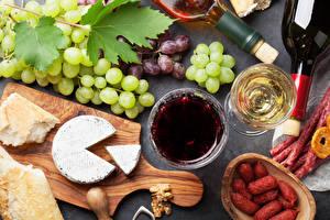 Photo Wine Grapes Cheese Sausage Bread Stemware Cutting board Food