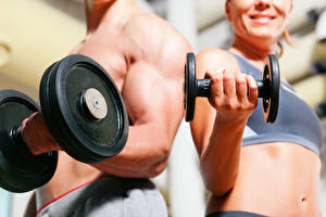 Pictures Closeup Fitness Men Bokeh Muscle Two Hands Dumbbells athletic Girls