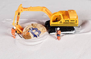 Fotos Münze Bitcoin Spielzeuge Bagger Sand