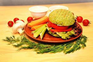 Fotos Dill Burger Pilze Tomaten Gemüse Teller vegan das Essen