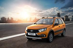 Pictures Lada Russian cars Motion Orange Metallic 2018 Granta Cross auto