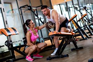 Picture Men Gym Physical exercise Two Sitting Dumbbells sports Girls