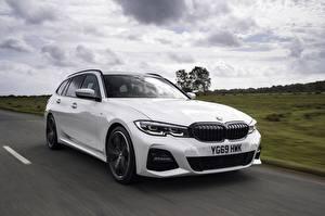 Pictures BMW White Metallic Moving Estate car G21 3-series 330i Touring Cars