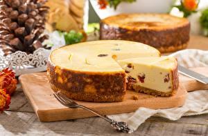 Fotos & Bilder Käsekuchen Stück Gabel Lebensmittel