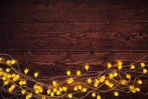 Fotos & Bilder Neujahr Bretter Vorlage Grußkarte Lichterkette Lebensmittel