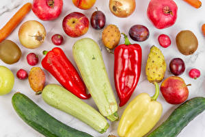 Photo Cucumbers Courgette Bell pepper Onion Pomegranate Apples Kiwifruit Plums Radishes