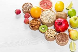 Fotos & Bilder Obst Orange Frucht Granatapfel Äpfel Birnen Nussfrüchte Zitrone Kiwi Müsli Mandeln Lebensmittel