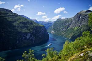 Hintergrundbilder Norwegen Berg Bucht Felsen Geiranger Fjord Natur