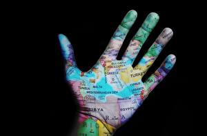 Desktop wallpapers Fingers Geography Closeup Creative Map Black background Hands Tourism