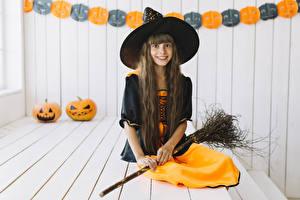 Pictures Halloween Pumpkin Witch Little girls Hat Smile Glance Sit Children