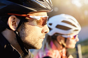 Photo Men Blurred background Two Helmet Glasses Side cyclist