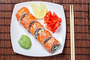 Bilder Sushi Zitronen Fische - Lebensmittel Teller Essstäbchen