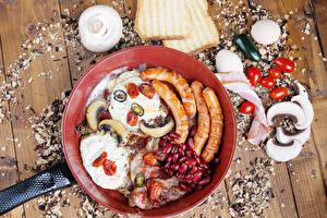 Bilder Frankfurter Würstel Pilze Brot Schinken Tomaten Paprika Bretter Bratpfanne Spiegelei Ei