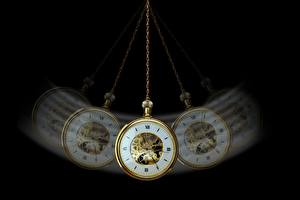 Image Clock Watch Black background hypnosis